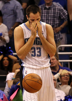 ORLANDO, FL - MARCH 30:  Ryan Anderson #33 of the Orlando Magic holds his nose following a 98-100 loss to the Dallas Mavericks at Amway Center on March 30, 2012 in Orlando, Florida.  NOTE TO USER: User expressly acknowledges and agrees that, by downloadin