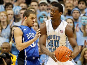 CHAPEL HILL, NC - FEBRUARY 08:  Seth Curry #30 of the Duke Blue Devils and Harrison Barnes #40 of the North Carolina Tar Heels during their game at the Dean Smith Center on February 8, 2012 in Chapel Hill, North Carolina.  (Photo by Streeter Lecka/Getty I