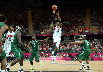 LONDON, ENGLAND - AUGUST 02:  Kobe Bryant #10 of United States shoots Chamberlain Oguchi #9 of Nigeria in the first half during the Men's Basketball Preliminary Round match on Day 6 of the London 2012 Olympic Games at Basketball Arena on August 2, 2012 in