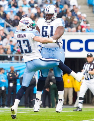 CHARLOTTE, NC - NOVEMBER 13: Fernando Velasco #61 of the Tennessee Titans celebrates with Marc Mariani #83 after Mariani returned a punt 79 yards for a touchdown against the Carolina Panthers at Bank of America Stadium on November 13, 2011 in Charlotte, N