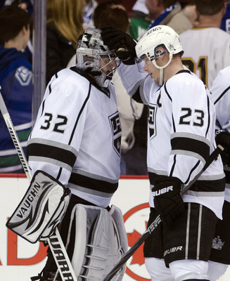 Jonathan Quick (left) and Dustin Brown (right) celebrate a victory against the Vancouver Canucks in the opening round of the 2012 Stanley Cup Playoffs.