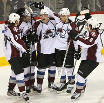 Members of the Avalanche celebrate a goal in Winnipeg.