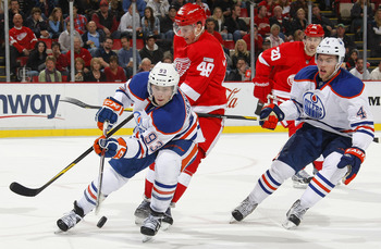 Rookie sensation Ryan Nugent-Hopkins (#93) evades a Detroit Red Wing while Taylor Hall (#4) looks on.