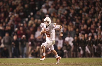 Nov 24, 2011; College Station, TX, USA; Texas Longhorns quarterback Case McCoy (6) scrambles against the Texas A&M Aggies during the second half at Kyle Field. Texas won 27-25. Mandatory Credit: Thomas Campbell-US Presswire
