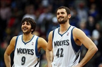 Jan 18, 2012; Minneapolis, MN, USA; Minnesota Timberwolves guard Ricky Rubio (9) and forward Kevin Love (42) smile during the fourth quarter against the Detroit Pistons at the Target Center. The Timberwolves defeated the Pistons 93-85. Mandatory Credit: B