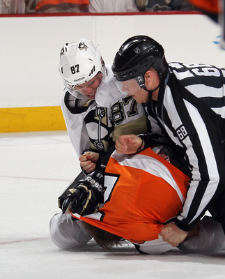 Crosby keeps going even after the linesman steps in.