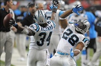 DeAngelo Williams (34) and Jonathan Stewart (28) boogie down after a score.