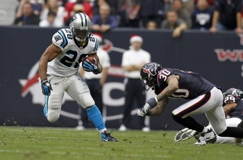 Jonathan Stewart (28) runs free against the Houston Texans in 2011.
