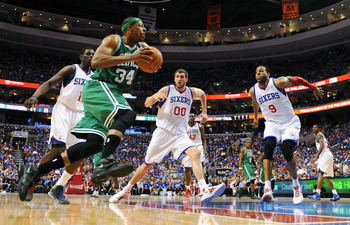 Pierce drives against a trio of Sixers defenders.