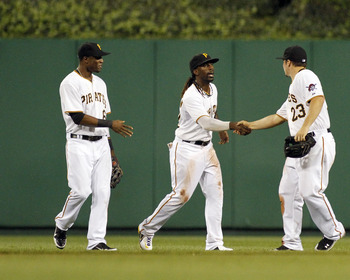 PITTSBURGH, PA - AUGUST 8:  Andrew McCutchen #22 of the Pittsburgh Pirates celebrates with fellow outfielders Starling Marte #6 and Travis Snider #23 after defeating the Arizona Diamondbacks on August 8, 2012 at PNC Park in Pittsburgh, Pennsylvania.  The