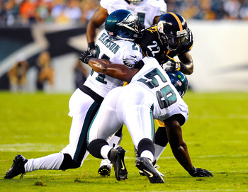 August 9, 2012; Philadelphia, PA, USA; Pittsburgh Steelers running back Chris Rainey (22) is tackled by Philadelphia Eagles defensive back Joselio Hanson (21) and linebacker DeMeco Ryans (59) during the first quarter at Lincoln Financial Field. Mandatory