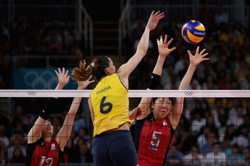 LONDON, ENGLAND - AUGUST 09:  Erika Araki #5 and Risa Shinnabe #12 of Japan defend the ball from Thaisa Menezes #6 of Brazil during the Women's Volleyball semifinal match on Day 13 of the London 2012 Olympics Games at Earls Court on August 9, 2012 in Lond