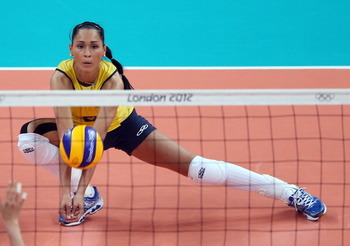 LONDON, ENGLAND - AUGUST 09:  Jaqueline Carvalho #8 of Brazil passes the ball in the second set against Japan during the Women's Volleyball semifinal match on Day 13 of the London 2012 Olympics Games at Earls Court on August 9, 2012 in London, England.  (