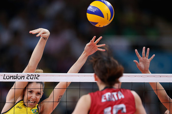 LONDON, ENGLAND - AUGUST 09: Thaisa Menezes #6 of Brazil defends the ball from Yukiko Ebata #16 of Japan during the Women's Volleyball semifinal match on Day 13 of the London 2012 Olympics Games at Earls Court on August 9, 2012 in London, England.  (Photo