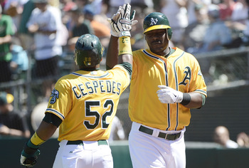 Yoenis Cespedes high-fives Chris Carter (pictured right).