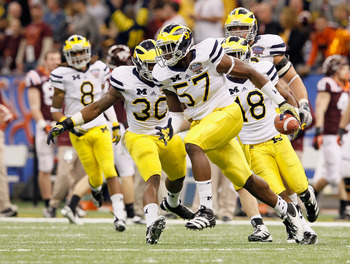 Wolverines DE Frank Clark was charged with home invasion after allegedly stealing a laptop from a student's room