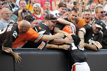 CLEVELAND, OH - AUGUST 13: Josh Cribbs #16 of the Cleveland Browns celebrates in the dog pound after scoring a touchdown during the first quarter against the Green Bay Packers at Cleveland Browns Stadium on August 13, 2011 in Cleveland, Ohio. (Photo by Ja