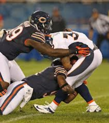 Here's Thomas assisting Henry Melton on a tackle.