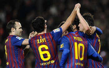 Villa with Iniesta, Xavi, and Messi during FC Barcelona Match