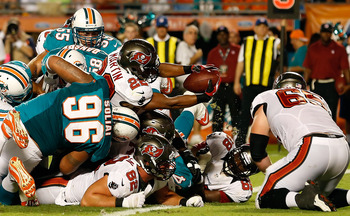Doug Martin reaches for the goal line against the Dolphins