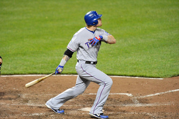 Josh Hamilton watches one of his four home runs sail over the wall at Oriole Park earlier this season.
