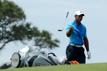 KIAWAH ISLAND, SC - AUGUST 10: Tiger Woods of the United States tosses his club after a shot on the third hole during Round Two of the 94th PGA Championship at the Ocean Course on August 10, 2012 in Kiawah Island, South Carolina.  (Photo by Andrew Redingt