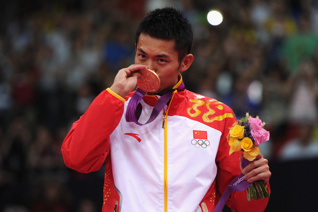 LONDON, ENGLAND - AUGUST 05:  Lin Dan of China celebrates with his Gold medal after winning his Men's Singles Badminton Gold Medal match against Chong Wei Lee of Malaysia on Day 9 of the London 2012 Olympic Games at Wembley Arena on August 5, 2012 in Lond