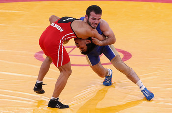 Dzhamal Otarsultanov (blue) taking down opponent at London Games.
