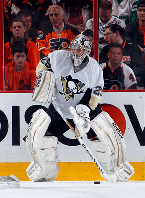 PHILADELPHIA, PA - APRIL 22:  Goalie Marc-Andre Fleury #29 of the Pittsburgh Penguins clears the puck against the Philadelphia Flyers in Game Six of the Eastern Conference Quarterfinals during the 2012 NHL Stanley Cup Playoffs at Wells Fargo Center on Apr