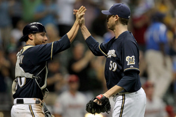 Celebrations have been few and far between for Brewers closer John Axford this season.