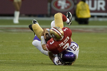 Vikings rookie Audie Cole sacks Scott Tolzien.