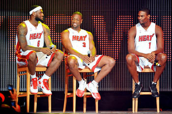 Lebron-james-dwyane-wade-chris-bosh-2010-miami-heat-introduction_photo_medium_display_image