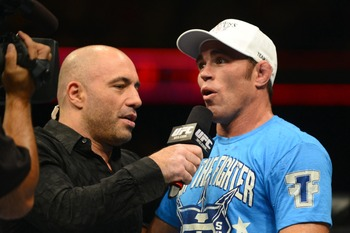 August 11, 2012; Denver, CO, USA; Joe Rogan (left) interviews Jake Shields (right) after he defeated Ed Herman (not pictured) during UFC 150 at the Pepsi Center. Mandatory Credit: Ron Chenoy-US PRESSWIRE