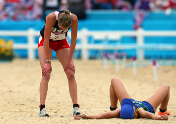 LONDON, ENGLAND - AUGUST 12:  Bronze medallist Yane Marques (R) of Brazil collapses after the line in the Women's Modern Pentathlon on Day 16 of the London 2012 Olympic Games on August 12, 2012 in London, England.  (Photo by Alexander Hassenstein/Getty Im