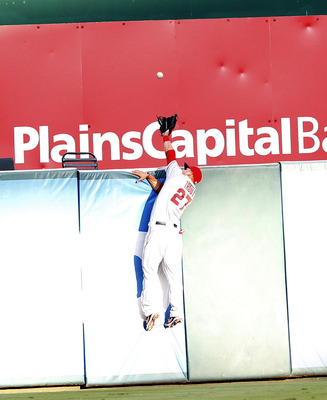 ARLINGTON, TX - AUGUST 2: Mike Trout #27 of the Los Angeles Angels of Anaheim jumps for a home run ball hit by Ian Kinsler of the Texas Rangers in the first inning at Rangers Ballpark in Arlington on August 2, 2012 in Arlington, Texas. (Photo by Rick Yeat