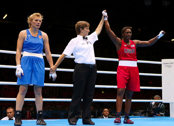 U.S. boxer Claressa Shields became the youngest Olympic boxing champion ever, winning the women's middleweight division.