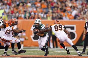 CINCINNATI, OH - AUGUST 10: Tim Tebow #15 of the New York Jets gets pressured by Manny Lawson #99 of the Cincinnati Bengals during a preseason NFL game at Paul Brown Stadium on August 10, 2012 in Cincinnati, Ohio. (Photo by Joe Robbins/Getty Images)