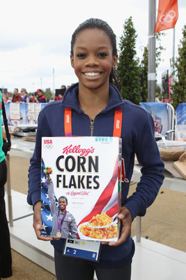 Gabby Douglas poses with her Corn Flakes box.
