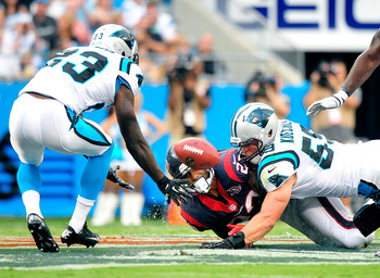 CHARLOTTE, NC - AUGUST 11:  Luke Kuechly #59 of the Carolina Panthers forces a fumble as he tackles Arian Foster #23 of the Houston Texans during a preseason game at Bank of America Stadium on August 11, 2012 in Charlotte, North Carolina.  (Photo by Grant