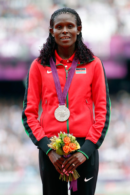 LONDON, ENGLAND - AUGUST 04:  Bronze medalist Jepkemoi Vivian Cheruiyot of Kenya poses on the podium during the medal ceremony for the Women's 10,000m on Day 8 of the London 2012 Olympic Games at Olympic Stadium on August 4, 2012 in London, England.  (Pho