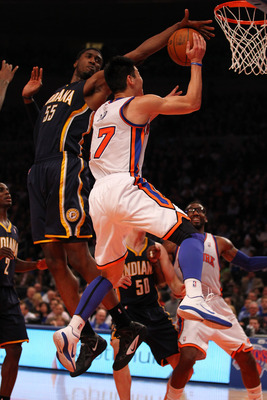 Roy Hibbert of the Indiana Pacers blocking Jeremy Lin