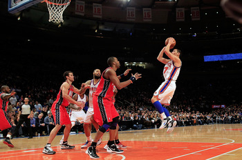 Jeremy Lin taking a jumper against the New Jersey Nets