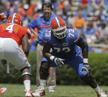 April 7, 2012; Gainesville FL, USA; Florida Gators head coach Will Muschamp (in back) watches as tackle Xavier Nixon (73) gets ready to block during the first half of the Florida-Spring Game at Ben Hill Griffin Stadium. Mandatory Credit: Phil Sears-US PRE