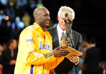 Lamar Odom, being named the 2011 NBA  Sixth Man of the Year.