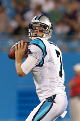 Jimmy Clausen (7) drops back for a pass in a preseason game against the Houston Texans.