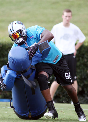 Charles Johnson (95) sheds a dummy at training camp.