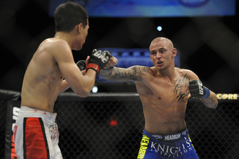 May 15, 2012; Fairfax, VA, USA; Dustin Poirier (right) looks for an opening on the Korean Zombie (left) during the Korean zombie vs Poirier event at Patriot Center.  Mandatory Credit: Rafael Suanes-US PRESSWIRE