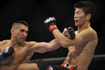 Jun 22, 2012; Atlantic City, NJ, USA; Ricardo Lamas (left) fights Hatsu Hioki in a featherweight bout during UFC on FX at Revel Resort and Casino.  Ricardo Lamas won the fight by unanimous decision in the third round.  Mandatory Credit: Joe Camporeale-US