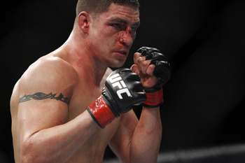 Feb 15, 2012; Omaha, NE, USA; Jake Ellenberger (not pictured) fights with Diego Sanchez in the main event during UFC on Fuel TV 1 at Omaha Civic Auditorium. Mandatory Credit: Matt Ryerson-US PRESSWIRE