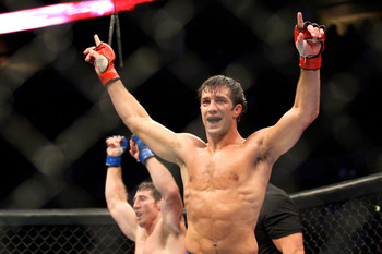 July 14, 2012; Portland, OR, USA; Luke Rockhold celebrates his win over Tim Kennedy in the middleweight championship fight at MMA Strikeforce at the Rose Garden Arena. Mandatory Credit: Scott Olmos-US PRESSWIRE